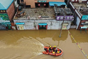 Henan province, China: rescue workers evacuate residents following heavy rain
