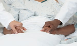 Doctors holding a patient's hand