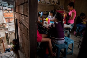 Children have lunch in a common dining room consisting of mothers and social leaders from a social initiative called Caracas Mi Convive