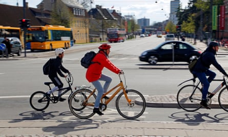 Child cycles with adult in Copenhagen