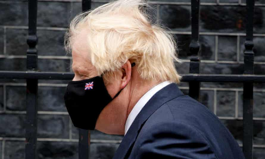 Boris Johnson in a black face mask