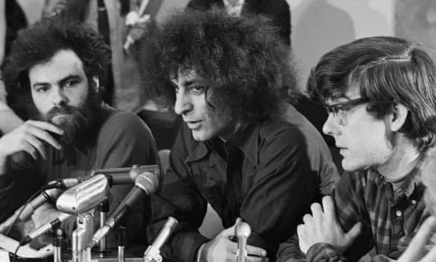 Jerry Rubin, Abbie Hoffman and Rennie Davis speak to the press during a break in their 1969 trial.