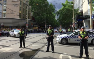 Policemen block members of the public from walking towards the Bourke Street mall in central Melbourne.