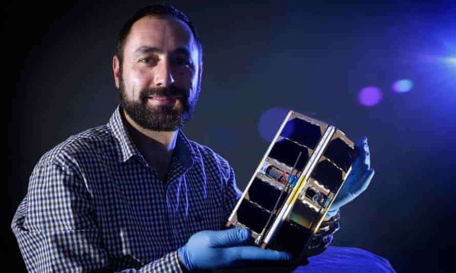 Dr Elias Aboutanios holds a cubesat.