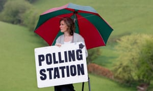 Residing Polling officer Sharon Gullick outside rural polling station at Shirwell in North Devon during election time, UK
