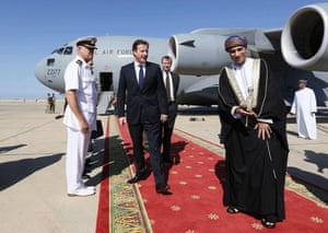 Oman's Sayyid Fahd bin Mahmoud al-Said greets David Cameron in December 2012 after his arrival in Muscat