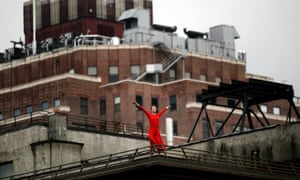 A dancer from the Trisha Brown Dance Company performs during Roof Piece above the High Line park in 2011 in New York City.