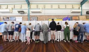 Voters go into the polling box.