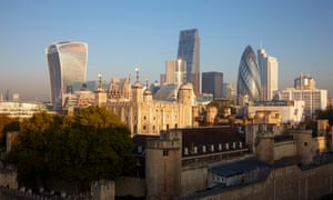 The Tower of London and the City skyline on a clear, blue sunny winter's day.