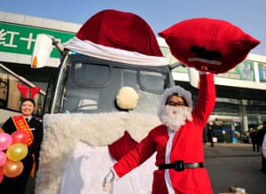A long-distance bus decorated as Santa Claus along with its driver in Jinan, China