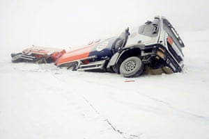 A petrol truck lies partially through the ice on the Aldan River while driving along an authorised river crossing site near the Megino-Aldan settlement in the Tomponsky District