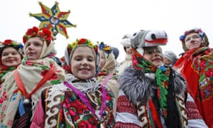 Ukrainian children in traditional dress at the star of Bethlehem procession Sophia Square, Kiev.