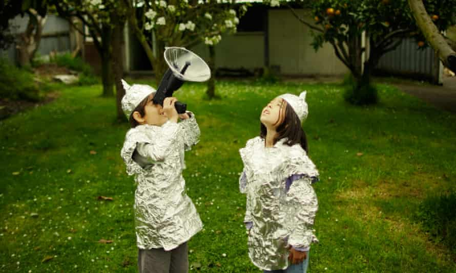 Children wear protective baking foil whilst watching out for possible alien invasion.