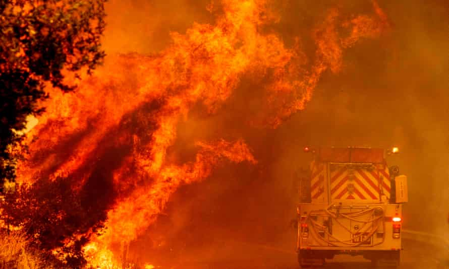 A fire truck drives through flames as the Hennessey fire continues to rage out of control near Lake Berryessa in Napa, California.