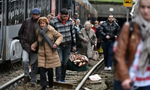 People evacuate a tram during an anti-terrorist operation in Brussels on Friday.