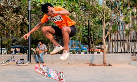 A youth performs a skateboard trick at a skatepark in Mumbai