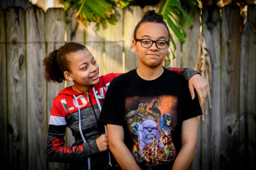 Sarah Davis's daughters Magnolia,16, left, and Chloe Clark, right, 18, pose for a portrait in their backyard in the Mid-City Neighborhood of New Orleans, La., on Saturday, April 27, 2019.