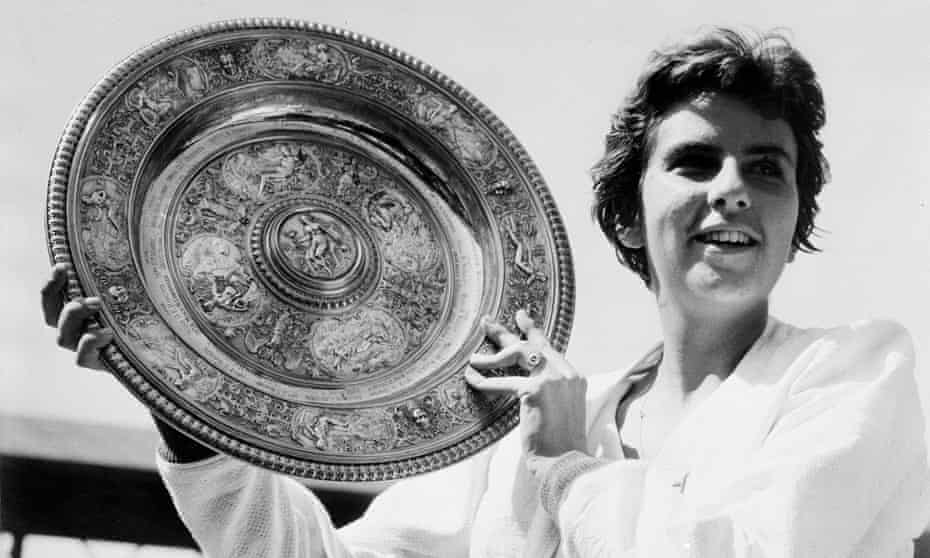 Maria Bueno holds up the trophy after winning the women's singles final at Wimbledon.