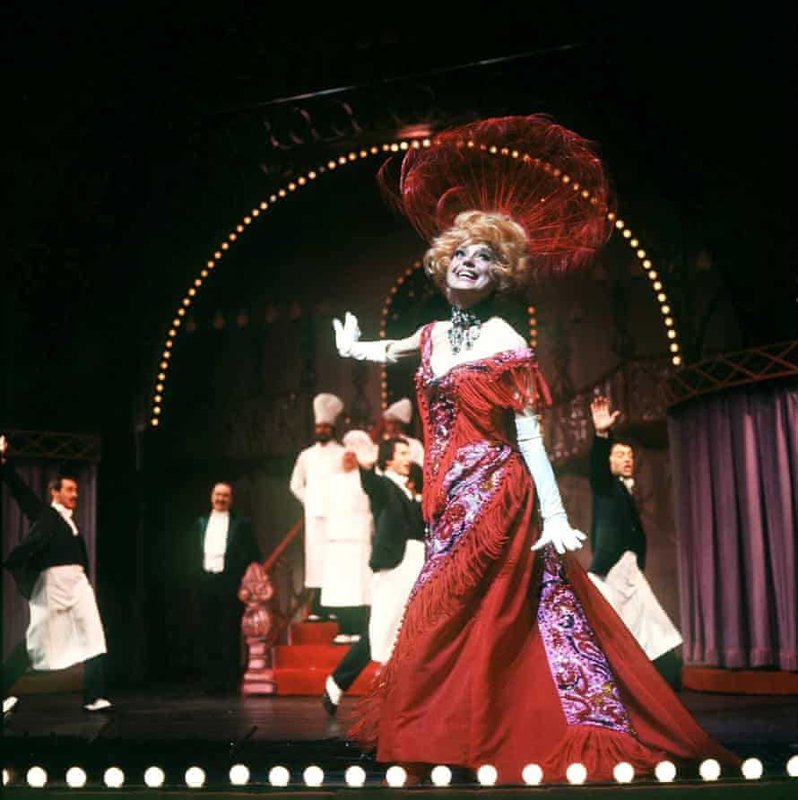 Donning a hat as feathery as her eyelashes ... Channing as matchmaking widow Dolly Levi in Hello, Dolly!