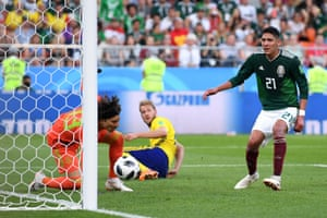 Everyone can only watch as Edson Alvarez of Mexico puts the ball into his own net.
