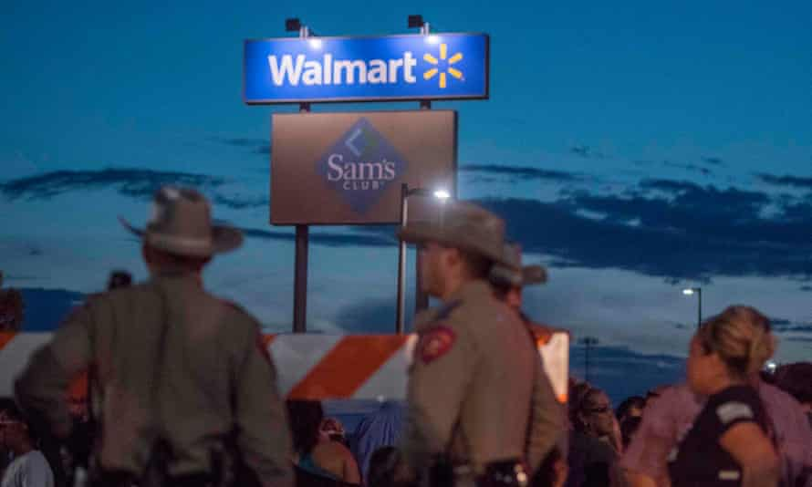 Texas state troopers keep watch at the makeshift memorial for victims of the mass shooting at a Walmart in El Paso. The retailer subsequently announced it would stop selling ammunition for assault rifles.