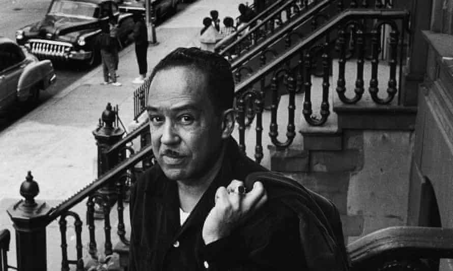 Langston Hughes on the steps of his house in Harlem, in 1958.