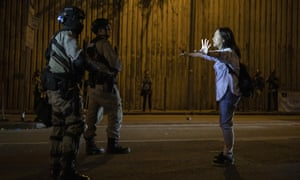 Hong Kong: Chinese troops deployed to help clear roadblocks | World news | The Guardian