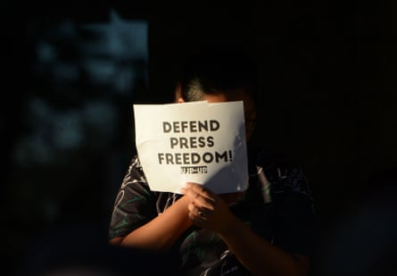 A student holds a placard during a protest at the state university grounds in Manila this month in support of Maria Ressa.