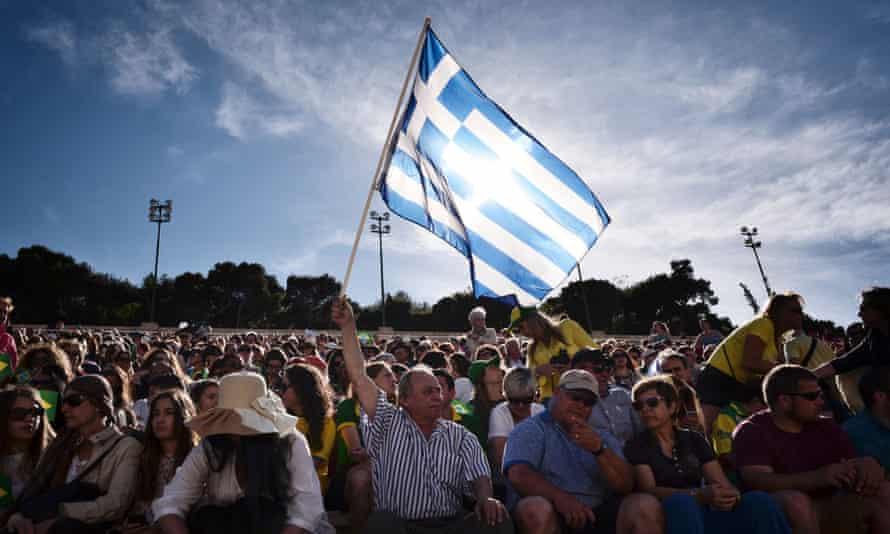 A man holds a Greek flag. Greece may soon get some debt relief from its creditors.