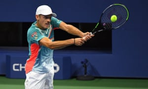Australia's Alex de Minaur returns