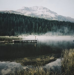 On an autumn morning, Lej da Staz in the Engadin valley, near St Moritz, transformed into a fairytale setting as a layer of mist hovered over the lake