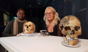 Dr Onyeka Nubia and Dr Alex Hildred with the skulls of 'Henry' and the archer royal.