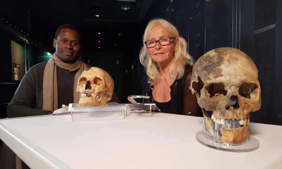 Onyeka Nubia (left) and Alex Hildred with the skulls of 'Henry' (background) and the 'archer royal'