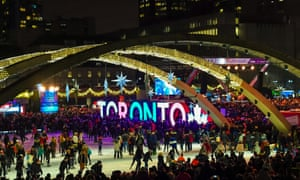 Crowd skating and surrounding the Freedom Arches in Nathan Phillips Square, Toronto