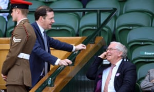 George Osborne chatting with Mervyn King, the former Bank of England governor, at Wimbledon today.