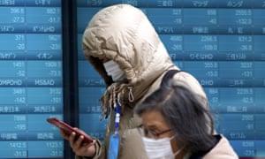 Masked people in Tokyo.
