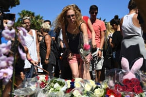 Nice, France A woman lays a flower in the street of Nice to pay tribute to the victims