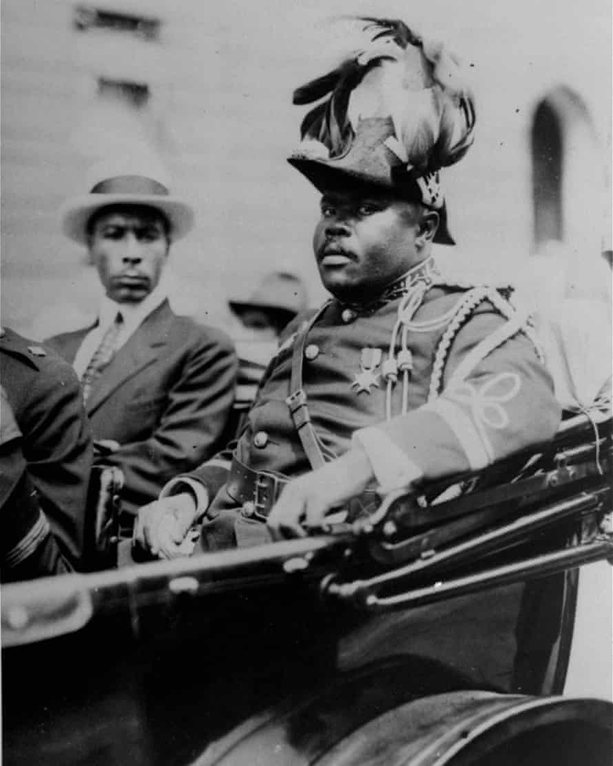 Marcus Garvey is shown in a military uniform as the 'provisional president of Africa' during a parade on the opening day of the annual Convention of the Negro Peoples of the World along Lenox Avenue in Harlem, New York, in August 1922.