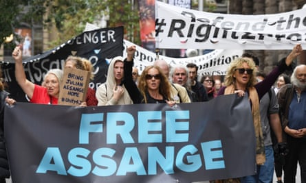 Supporters of Julian Assange and WikiLeaks are seen during a snap rally in Sydney, Friday, April 12, 2019. (AAP Image/Peter Rae) NO ARCHIVING
