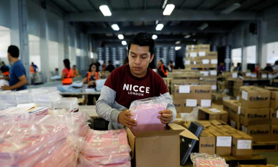 An employee arranges ballots at a warehouse before Sunday's first-round general election, in Guatemala City, Guatemala on Tuesday.