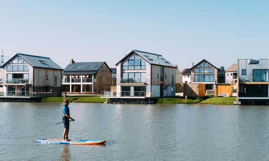 Paddleboarding on Beaumont Lake, Silverlake, Dorset.