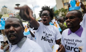 Kenyan anti-gay activists wear T-shirts reading 'Protect the family: March'