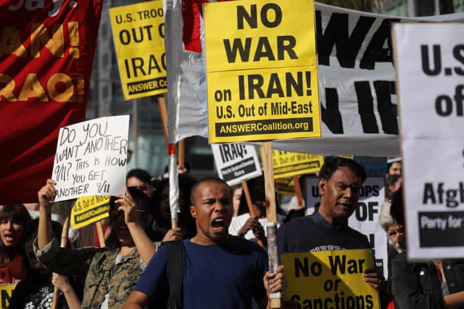 Adam Wimberly shouts slogans with others protesting the US involvement in the Middle East at Pershing Square in Los Angeles.
