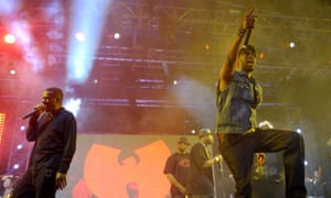 Members of the Wu-Tang Clan perform in front of their band logo in Indio, California, on 21 April 2013.