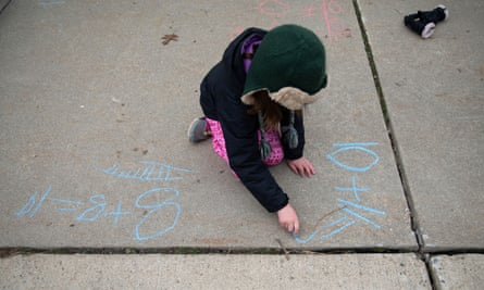 Molly Maguire, 8, uses chalk to calculate an addition problem in her driveway. At least 55.1 million students have been impacted by school closures during the pandemic.