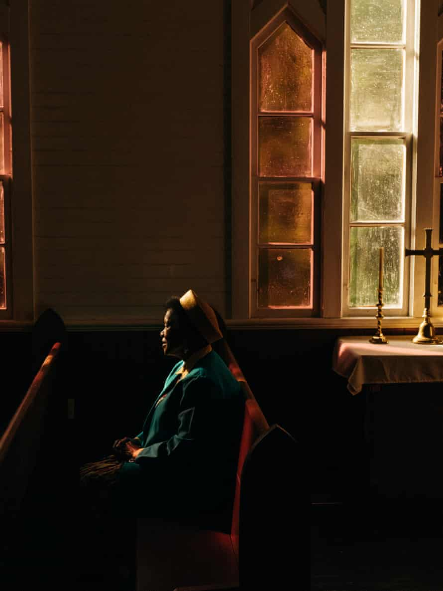 An image of a woman in a church in Georgia, US, from Robbie Lawrence's book Blackwater River
