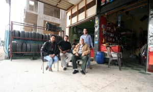This patriarch (seated, first from right) came to 10th of Ramadan from a village in southern Egypt for employment in the late 1970s. He has owned this garage since 1979 and the sons are now responsible for managing the business.