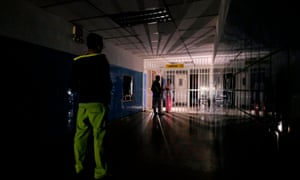 A man stands on a dark corridor at Miguel Pérez Carreno hospital, in Caracas, during the worst power outage in Venezuela's history, on Friday.
