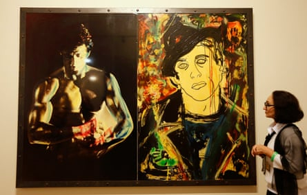 A woman looks at the painting The Arena at Sylvester Stallone. Painting. From 1975 Until Today, at the Russian Museum in St. Petersburg in 2013.