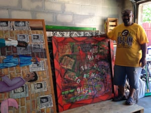 Michelangelo Lovelace with some of his paintings, including one from the Rodney King series.